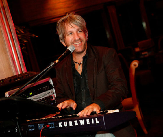 Playing piano at a corporate function in 2011